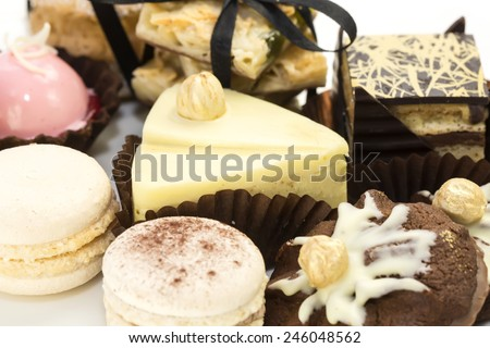 tasty biscuits with cream and chocolate on a white background - stock photo