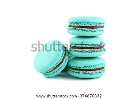 Tasty blue macarons isolated on white - stock photo