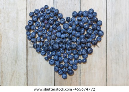 Tasty blueberries fruit on wooden background with copy space. Blueberries are antioxidant organic superfood. - stock photo