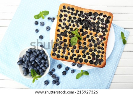 Tasty blueberry pie on table - stock photo