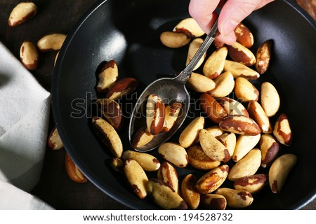 Tasty brasil nuts in pan, close up - stock photo