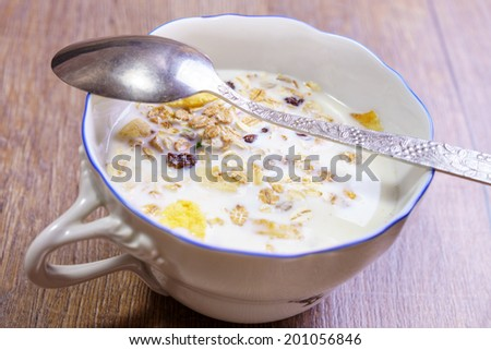 Tasty breakfast with cereals and berries under milk  - stock photo