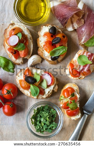 Tasty bruschettas with grilled tomatoes and bacon from above,selective focus - stock photo