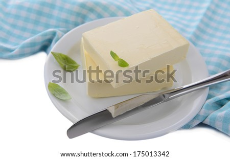Tasty butter on plate, isolated on white - stock photo