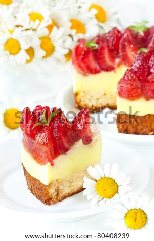 Tasty cake with cream and strawberries.