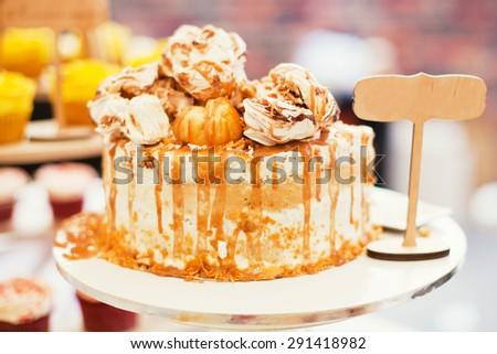 tasty cake with meringue and caramel - stock photo