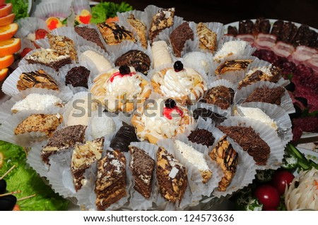 Tasty cakes on banquet table - stock photo