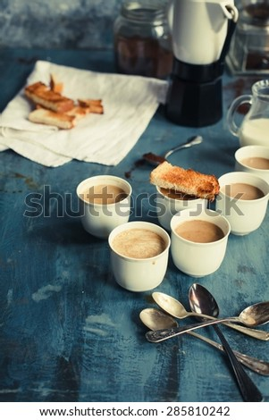 Tasty cappuccino or coffee with milk served on blue rustic table. Hot drink concept. Rustic style. - stock photo