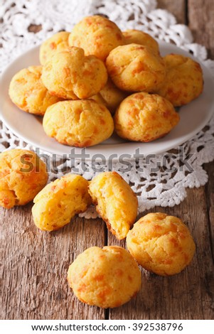 Tasty cheese buns gougere close-up of a plate on the table. vertical, rustic - stock photo