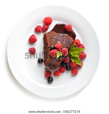 Tasty chocolate biscuit with fresh fruits isolated over white - stock photo