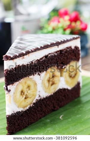 Tasty Chocolate cake with banana  sliced and served on banana leaf - stock photo