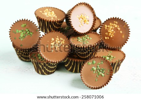 Tasty chocolate candies on wooden table - stock photo