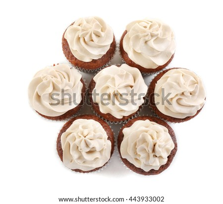 Tasty chocolate cupcakes, isolated on white - stock photo