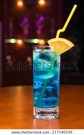 Tasty cocktail with blue curacao on bar counter - stock photo