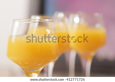 tasty cocktail with juice. a party at the bar on a gray background - stock photo