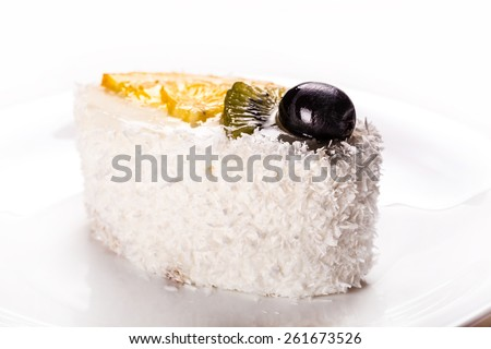 tasty coconut cake slice close-up on a white background - stock photo