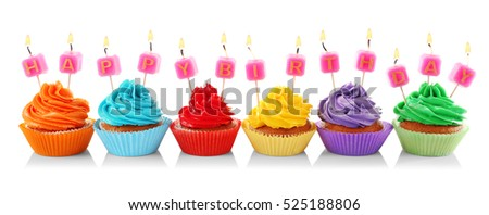 Tasty colorful cupcakes with Happy Birthday candles on white background