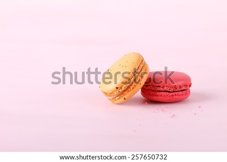 tasty colorful macarons on pink background - stock photo
