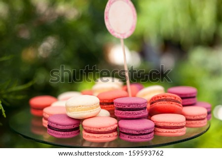 Tasty colorful macaroons on plate - stock photo
