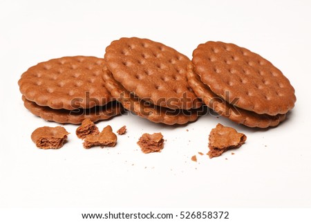 Tasty cookies with crumbs on white background