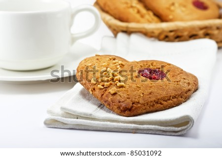 Tasty cookies with cup of tea