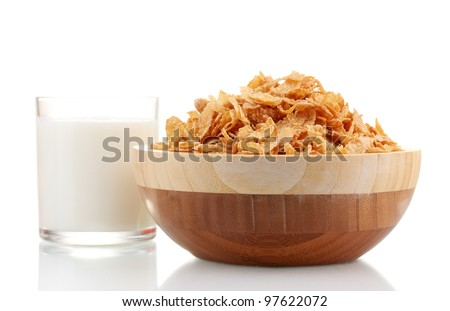 tasty cornflakes in wooden bowl and glass of milk isolated on white