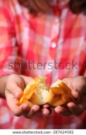 Tasty cupcake in female hands - stock photo