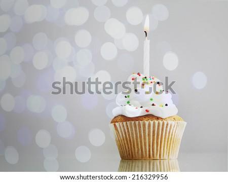 Tasty cupcake on bright background - stock photo