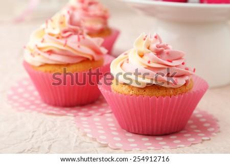 Tasty cupcake on pink background - stock photo