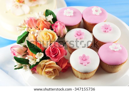 Tasty cupcake on stand, close-up - stock photo