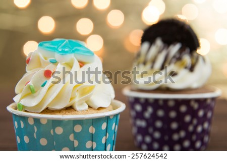 Tasty cupcake with butter cream on lights background - stock photo