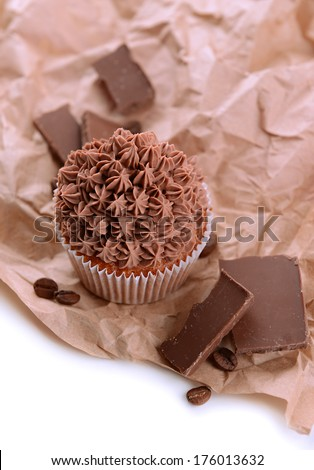 Tasty cupcake with butter cream, with decorations, isolated on white