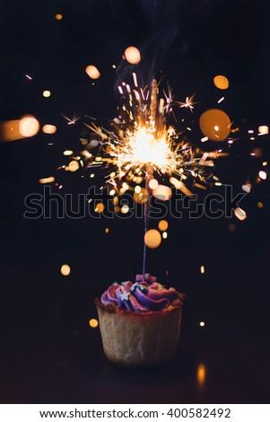 Tasty cupcake with sparkler - stock photo