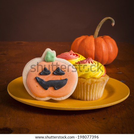 Tasty cupcakes decorated for Halloween. - stock photo