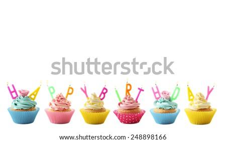 Tasty cupcakes isolated on white, happy birthday - stock photo