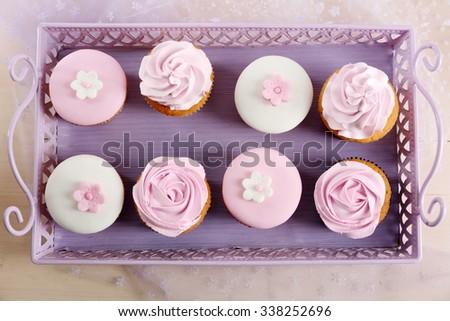 Tasty cupcakes on tray, close-up - stock photo