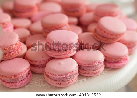 Tasty cupcakes on tray. Pastel colored cupcakes and meringue collage. - stock photo