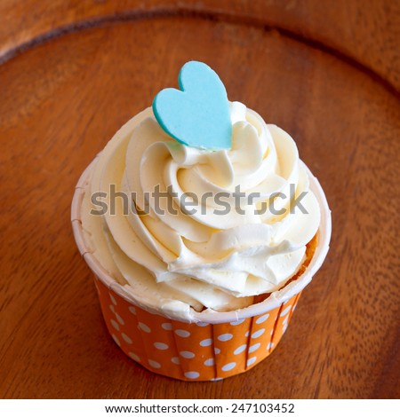 Tasty cupcakes with butter cream - stock photo
