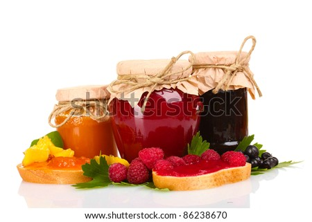 tasty currant jam and berries isolated on white - stock photo