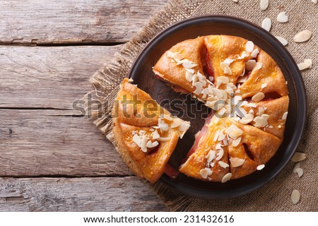 Tasty cutting almond pear pie closeup at the table. top view of the horizontal  - stock photo