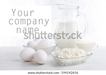 Tasty dairy products on wooden table - stock photo