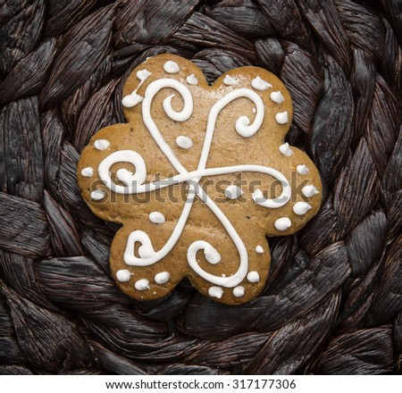 Tasty decorated gingerbread cookie. Christmas holidays. Yuletide. - stock photo