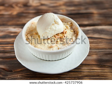 Tasty dessert with an ice cream ball on dark wooden background