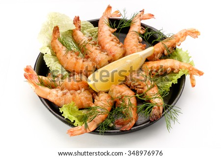 Tasty dish of shrimp on a white background, professional chef cooked in the restaurant. - stock photo