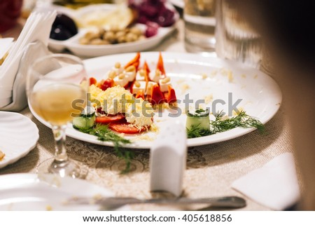 tasty dish with fresh tomatoes, peppers and zucchini on a table covered with cheese - stock photo