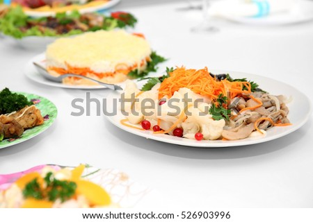 Tasty dishes on served wedding table