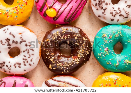 tasty donuts on paper close up - stock photo