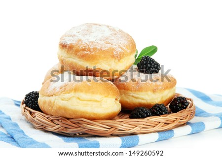 Tasty donuts with berries, isolated on white