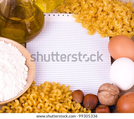 Tasty food ingredients and Italian pasta penne on banner add - stock photo