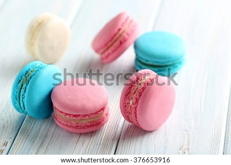 Tasty french macarons on a blue wooden table - stock photo